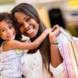 Foto Stock: Mother and daughter shopping