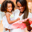 Mother shopping clothes for her daughter — Stock Photo