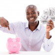 Stock Photo: Msaving money in piggybank