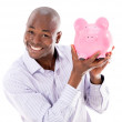 Stock Photo: Business mwith piggybank