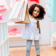 Stock Photo: Cute girl with shopping bags