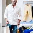 Stock Photo: Happy shopping man