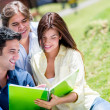 Friends studying at the park — Stock Photo