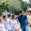 Stock Photo: Friends walking at park
