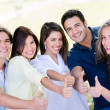 Happy friends with thumbs up — Stock Photo #30214849