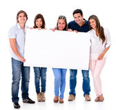 Group of people holding a banner — Stock Photo