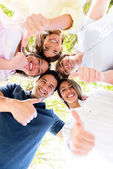 Group of friends with thumbs up — Stock Photo