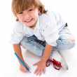 Foto Stock: Happy boy coloring