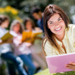 Beautiful girl studying outdoors — Stock Photo #30259887