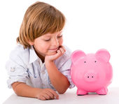 Boy with a piggybank — Stock Photo