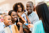 Shopping family at the cashier — Stock Photo