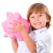 Stock Photo: Boy holding piggybank