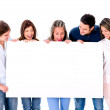 Casual group holding a banner — Stock Photo #30394137