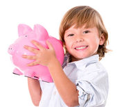 Boy holding a piggybank — Stock Photo
