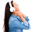 Happy womlistening to music — Stock Photo #30447087