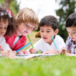 Stock Photo: Happy school kids coloring