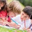 Group of kids coloring — Stock Photo