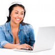 Stock Photo: Woman downloading music