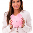 Stock Photo: Business womwith piggybank