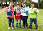 Happy group of school kids — Stock Photo