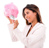 Woman taking money from a piggybank — Stock Photo