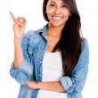 Happy woman pointing up — Stock Photo