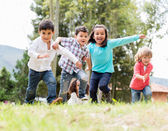 Happy kids playing — Stock Photo