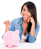 Casual woman saving money — Stock Photo