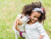 Happy girl with a dog — Stock Photo