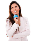 Thoughtful woman with a debit card — Stock Photo