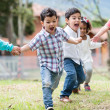 Group of kids running — Stock Photo