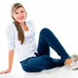 Casual woman sitting on the floor — Stock Photo