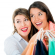 Stock Photo: Surprised female shoppers