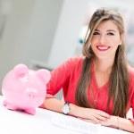 Business woman with a piggybank — Stock Photo #31163023