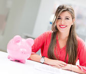 Business woman with a piggybank — Stock Photo