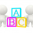 3D people with ABC cubes — Photo