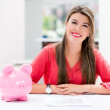 Stock Photo: Womsaving in piggybank
