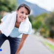 Woman resting while running — Stock Photo