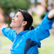 Happy woman exercising outdoors — Stock Photo