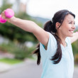 Excited woman training outdoors — Stock Photo