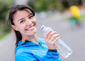 Woman hydrating after workout — Stock Photo