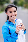 Sports woman drinking water — Stock Photo