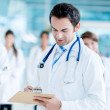 Doctor writing medical history — Stockfoto #31575109