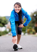 Fit woman stretching outdoors — Stock Photo