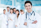 Doctor with medical staff — Stock Photo