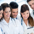 Doctors with a tablet — Stock Photo
