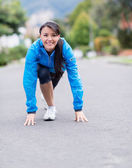 Fit woman ready to run — Stock Photo