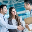 Family doctor handshaking a couple — Stock Photo
