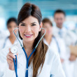 Stock Photo: Female doctor with a stethoscope
