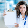 Doctor holding a clipboard — Stock Photo